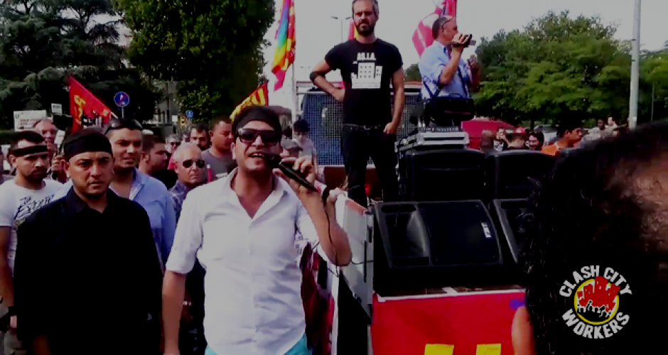 Demonstration, among the people a man with a microphone beside the vehicle with the loudspeakers